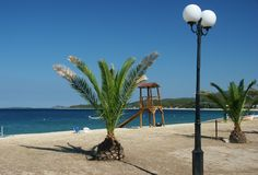 Greece. Sea with blue sky, lamp, palm, horizontally framed shot royalty free stock photo