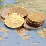 Greece. Map of Europe showing Greece with several Euro coins on top stock photography