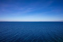 Greece. Aegean sea. Blue sky and calm sea water texture background. High angle view stock images