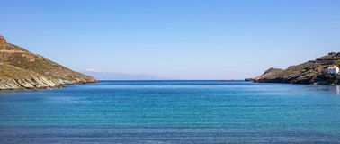 Greece. Aegean sea. Blue sky and calm sea water texture background. Greece. Aegean sea. Blue sky, calm turquoise sea water and snowed mountains, banner royalty free stock photos