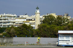Greece, Alexandroupolis. Lighthouse and buildings on harbor Royalty Free Stock Images