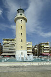 Greece, Alexandroupolis. Alexandroupolis, Greece - September 18, 2016: Lighthouse with fountain and building in the city in Eastmacedonia Stock Images