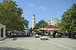 Greece, Alexandroupolis. Alexandroupolis, Greece - September 18, 2016: Unidentified people in restaurant and lighthouse in the city in Eastmacedonia Royalty Free Stock Image