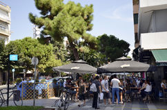 Greece, Alexandroupolis. Alexandroupolis, Greece - September 18, 2016: Unidentified people in street cafe, preferred place for drinks and talk Royalty Free Stock Photos