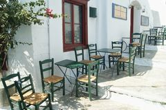 Greece, Amorgos, a cafe with tables and chairs. stock photography