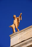 Greece Athens Archaeological Museum. Statue of a male figure on the roof-top Royalty Free Stock Photography