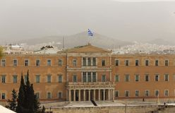 Greece, Athens pollution. Unhealthy grey smog over parliament at Syntagma. Sky, hill and town background. Royalty Free Stock Photo