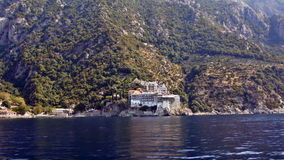 Greece, Athos, the Monastery of St. Gregory. Greece, Athos, September 15: The view from the side of the boat at the Monastery of St. Gregory September 15, 2016 Stock Image