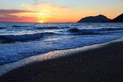 Greece beach sunset Stock Photos