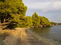 Greece beach on sunset light. Evening in the nature.   Fascinating landscape. Greece beach on sunset light. Evening in the nature.   Fascinating landscape into royalty free stock images