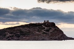 Greek temple of Poseidon at sunrise, Cape Sounio. Greece Cape Sounion. Ruins of an ancient temple of Poseidon at morning sunrise, view from distance royalty free stock photo