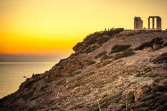 Greek temple of Poseidon at sunset, Cape Sounio. Greece Cape Sounion. Ruins of an ancient temple of Poseidon at sunset. Travel destinations royalty free stock images