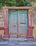 Greece, Chios island, vintage house entrance. Greece, Chios island, pale green door on vintage house stone wall facade Stock Images
