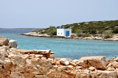 Greece church at the sea and stone wall. Greece, cyclades island: typical church close to the sea Stock Image