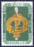 GREECE - CIRCA 1976: A stamp printed in Greece shows a gold goddess head from a silver pin, circa 1976.