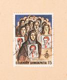 A stamp printed in Greece shows an image of people searching their missing relatives, circa 1982. GREECE - CIRCA 1982: A stamp printed in Greece shows an image stock photography