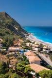 Greece coast. Beautiful coast scene with lush green cliff face in Lefkada, Greece Stock Images