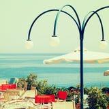 Greece coffee shop and sea Stock Photos