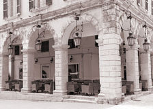 Greece. Corfu. Corfu town. An open-air cafe. Sepia Royalty Free Stock Photos