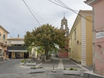 Greece, corfu, Doukades, september 28, 2018: Old square with big linden tree and taverns and stone traditional houses royalty free stock images