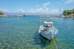 Fishing boat in the port of Kassiopi in Corfu, Greece stock photos