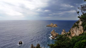Greece, Corfu: Rocks and sea around the Monastery `Life-giving Spring`. Greece, Corfu: View from the observation deck near the Monastery `Life-giving Spring` Stock Images