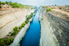 Greece, Corinth, August 2016 The Corinth Canal connects the Gulf of Corinth with the Saronic Gulf in the Aegean Sea. Deep canal from the bridge Royalty Free Stock Photo