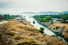 Greece, Corinth, August 2016 The Corinth Canal connects the Gulf of Corinth with the Saronic Gulf in the Aegean Sea. Ship in the middle of canal Stock Photo