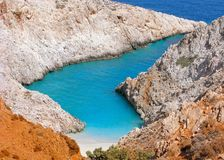 Greece, Crete, Seitan Limania beach. Greece, Crete. Beach of Seitan Limania in bay with turquoise water and an unusual shape. The beach is located only 22km stock photo