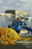 Greece, Crete. Fishing boat and venetian fortress in Heraklion aka Iraklio Stock Image