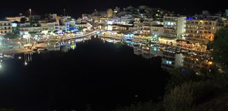Greece, Crete Island, Night landscape of Old port and lake at the Agios Nicolaos Stock Photos