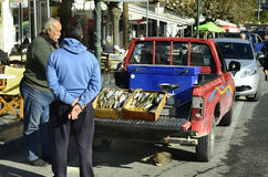 Greece, Crete. Neapoli, Greece - December 23rd 2013: Unidentified traveling salesman with fish for sale on car, a traditional kind of sale in parts of Crete royalty free stock photos