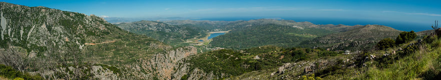 Greece, Crete Panorama of the island. Green hills and turquoise Stock Photo