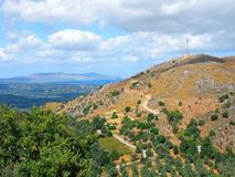 Greece, Crete, panoramic view, picturesque landscape with sea and with winding road in mountains royalty free stock images