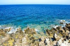 GREECE, CRETE, RETIMNO, SEA. Sea waves crashing over rocks on wild stone beach in Retimno, Crete, Greece Royalty Free Stock Photos