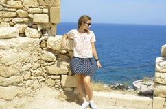GREECE, CRETE, RETIMNO. Young beautiful girl, Retimno castle in Crete Stock Photo