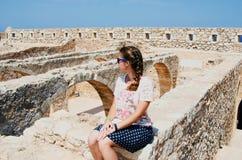 GREECE, CRETE, RETIMNO. Young beautiful girl, Retimno castle in Crete Stock Photos
