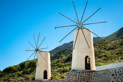 Greece, Crete, Windmills on the green hill Stock Photography