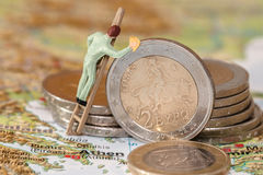 Greece debt crisis. Concept with a man cleaning the euro Royalty Free Stock Photography