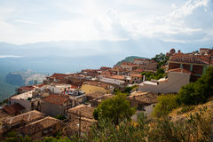 Greece, Delphi, August 2016, beautiful sun shining through the clouds lightning just part of hill. Panorama from one of city resta. Greece, Delphi, August Stock Photos