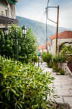Greece, Delphi, August 2016, one of beautiful narrow paths, street. Greece, Delphi, August , one of beautiful narrow paths, street, famous stairs in the city Royalty Free Stock Photo