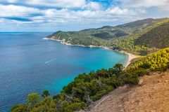 Greece. Destination. Skiathos island. Beautiful Seascape with greek Coast in Skiathos Island, Greece with turquoise water and fishing boat stock image