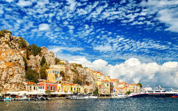 Greece. Dodecanesse. Island Symi Simi . Colorful houses on rocks Royalty Free Stock Photography