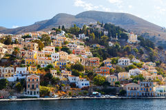 Greece. Dodecanesse. Island Symi Simi . Colorful houses on rocks Royalty Free Stock Images