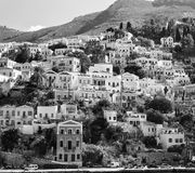 Greece. Dodecanesse. Island Symi Simi . Colorful houses on the rocks Stock Photo