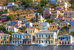 Greece. Dodecanesse. Island Symi Simi . Colorful houses on rocks Stock Image