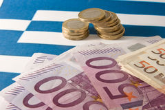 Greece and the EC. Money on a Greek flag Royalty Free Stock Photo