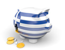 Greece economy and finance concept for bankruptcy, unemployment, and national debt crisis. Broken piggy bank with the Greek flag, representing the nation's debt Stock Photos