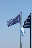 Greece and EU flags on blue sky background Stock Photo