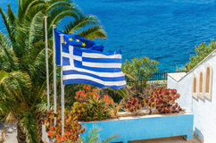Greece and European Union flag on the background of plam tree. And sea taken on Greek Island, Greece Royalty Free Stock Images